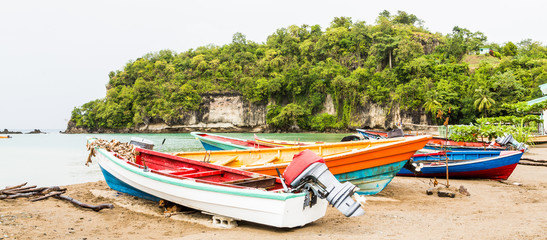 Four Colorful Fishing Boats on Beach