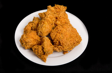 Fried Chicken on White Plate and Black Background