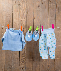 baby clothes on clotheslineм