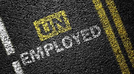 Employed Not Unemployed on the asphalt road