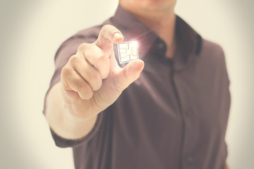 Man shows a shining digital chip