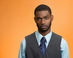 headshot sad depressed alone stressed man on orange background