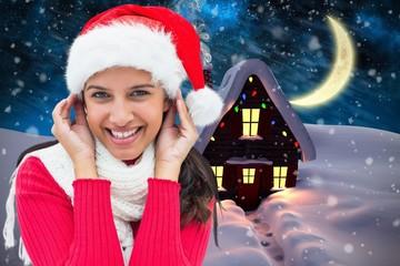 Composite image of festive brunette