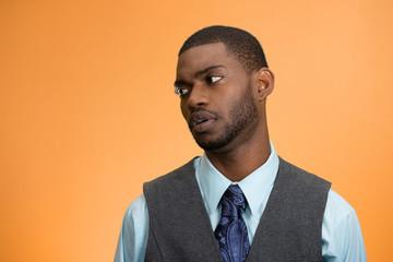 Portrait annoyed offended guy on orange background