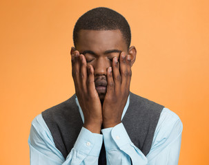 Portrait sad, upset depressed defeated man on orange background