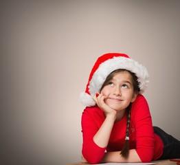 Composite image of festive girl thinking