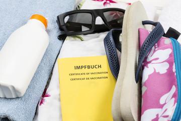 Reisegepäck mit Impfbuch