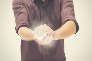 Man trying to hold the light between hands