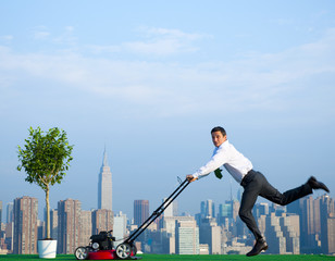 Green Businessman in the City mowing lawn