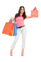 Trendy girl holding shopping bags