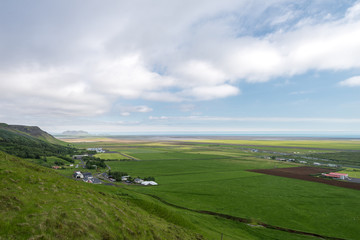 Typical coastal landscape with farms in South Iceland.