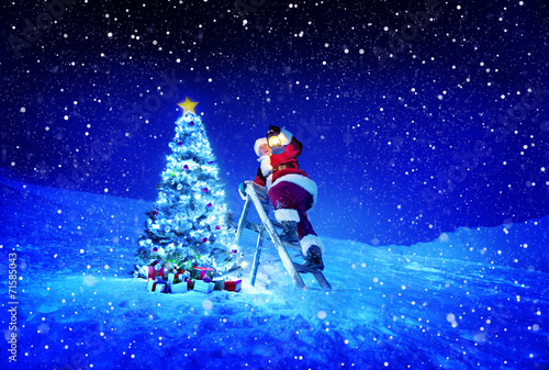 canvas print picture Santa with Lamp on a Step-Ladder by the Christmas Tree