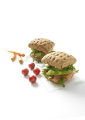 Healthy sandwiches with chicken and smoked salmon