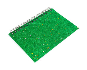 Green small notebook on a white background