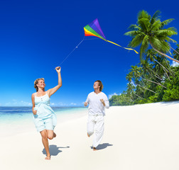 Couple Flying a Kite on the Beach