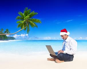 Businessman Working on the Beach on Christmas