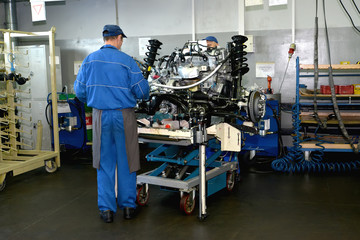 Work on a site of subassembly of automobile engines. Assembly sh