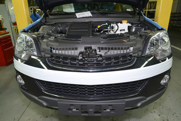 The car with an open cowl costs in assembly shop of automobile p