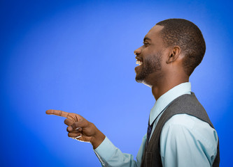 side profile man laughing pointing with finger at someone