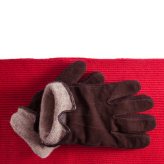 Brown gloves on red scarf