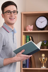 man standing and looking into camera at study at home.