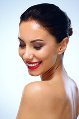 Portrait of a smiling beautiful woman with closed eyes