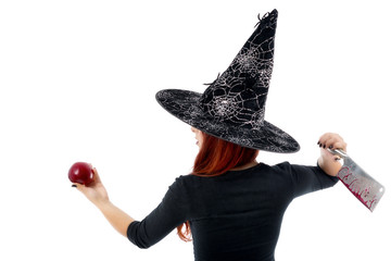 Tricky witch offering a poisoned apple, Halloween theme