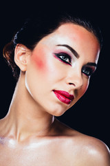 Portrait of a happy attractive woman with colourful makeup