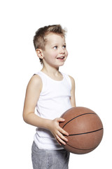 Young boy holding basketball, studio