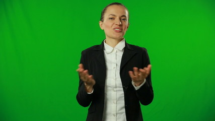 Brunette businesswoman talking on a green screen.FULL HD