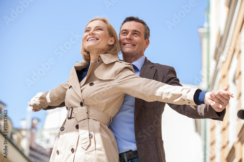 canvas print picture closeup shot of couple smiling and holding hands.