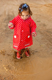 Jumping up and down on muddy puddles