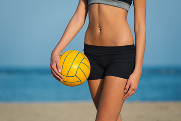 Close up of volleyball female player at the beach.