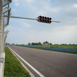 Empty formula one circuit with traffic lights. - 71588863