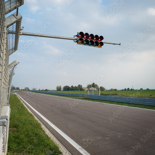 Empty formula one circuit with traffic lights.