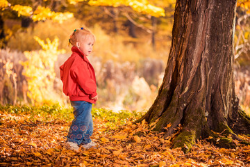 girl in red at fall forest