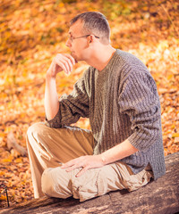 man in sweater at fall forest