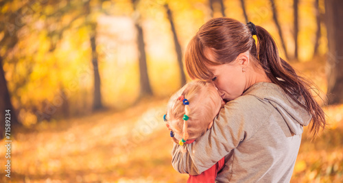 canvas print picture mother sharing love with daughter at fall forest