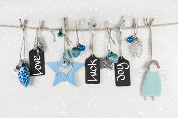 Christmas greeting card with text: love, luck, joy.