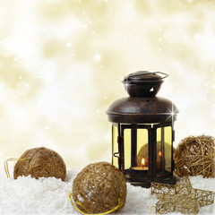 Christmas lantern and ornaments on snow