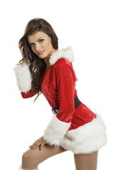 Sensual young lady in sexy Santa Claus costume isolated on white