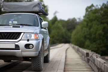 4x4 car on wooden bridge