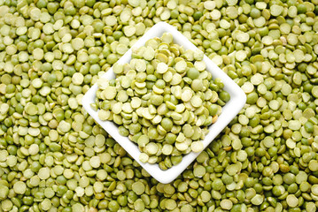 Background of Split Peas in a White Quare Bowl