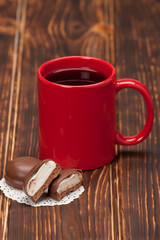 Red Mug Of Tea Or Coffee. Chocolate Marshmallows. Wooden Backgro