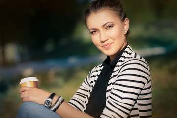 Woman holding hot beverage enjoying nature