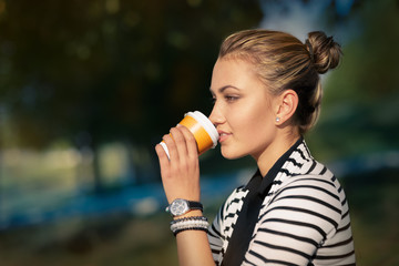 Woman drinking hot beverage enjoying nature