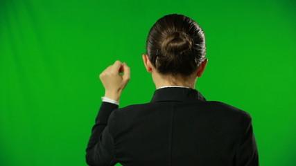 Woman is knocking hard on a green screen.FULL HD