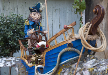Old Captain's  puppet  in his boat, selective focus