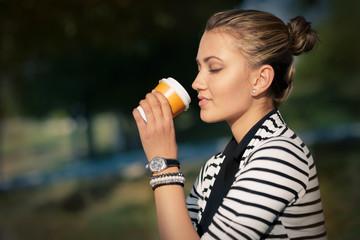Woman drinking hot beverage enjoying nature