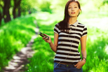 Happy weekend concept. Beautiful girl with smartphone